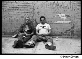 First page of Two men, one wearing a Studio 54 t-shirt, seated on the sidewalk with a can of beer