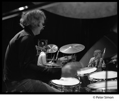 First page of Bill Kreutzman (Grateful Dead) playing drums in concert Mickey Hart and Phil Lesh visible in background