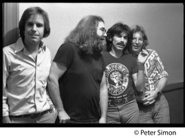 First page of Grateful Dead backstage (left to right): Bob Weir, Jerry Garcia, Mickey Hart, and Phil             Lesh