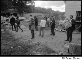First page of Members and friends of Packer Corners commune standing around outside the house Group includes, among others: Elliot Blinder (leather jacket), Laurie Dodge             (back to camera), Verandah Porche, Richard Wizansky, Marty Jezer, Harry Saxman, Don McLean