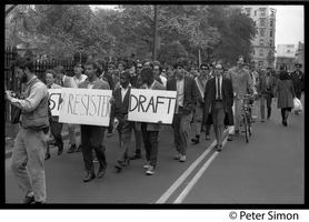 First page of Resistance rally: anti-draft and anti-Vietnam war protesters marching on Boylston Street near Emerson College Young African American men lead the pack carrying signs reading 'Resist,'             'Resister,' and  'Draft'