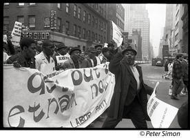 First page of Harlem Peace March: Progressive Labor Party march behind banner reading 'Get out of Vietnam now' African American antiwar protesters marching through the New York streets