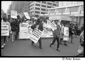 First page of Harlem Peace March: Progressive Labor Party march behind banner reading 'Get out of Vietnam now' African American antiwar protesters marching through the New York streets,             signs reading 'Black men should fight white racism, not Vietnamese freedom fighters'
