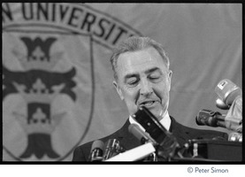 First page of Sen. Eugene McCarthy speaking at Sargeant Gymnasium, Boston University Close-up of McCarthy speaking at a podium behind a raft of microphones