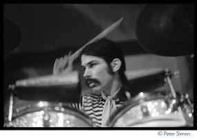 First page of Mickey Hart playing drums during Grateful Dead concert at the Ark