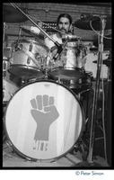 First page of Mickey Hart (Grateful Dead) performing on drums at MIT during the             student strike against the war in Vietnam and killings at Kent State Hart's bass drum is decorated with the clenched-fist symbol of the student             strike