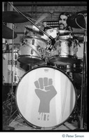 First page of Mickey Hart (Grateful Dead) performing on drums in concert at MIT during the             student strike against the war in Vietnam and killings at Kent State Hart's bass drum is decorated with the clenched-fist symbol of the student             strike