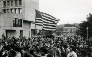 First page of Protesters on UMass Amherst campus, one waving a large American flag