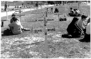 First page of Grave markers placed on lawn by UMass Amherst Pond commemorating victims of Contra violence in             Nicaragua