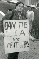 First page of Protester holding a sign reading 'Ban the CIA not protesters': in front of             Whitmore Building, UMass Amherst