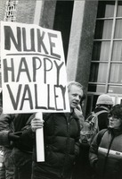 First page of Right wing protester at UMass Amherst with placard reading 'Nuke Happy Valley'