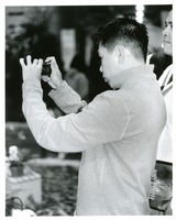 First page of Asian man shooting flower show