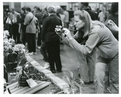 First page of Intent woman snaps flower show