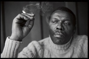 First page of Elvin Jones: half-length portrait of jazz musician, seated, smoking a cigarette