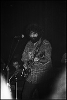 First page of Grateful Dead performing at the Music Hall: Jerry Garcia onstage, playing guitar