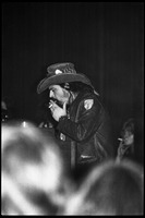 First page of Grateful Dead performing at the Music Hall: Ron 'pigpen' McKernan smoking a cigarette onstage