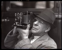 First page of Sam Connor and Bob Emery: man taking a picture with a Zeiss Ikon Super Ikonta camera