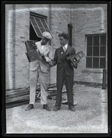 First page of Jack Dixon (left) and unidentified colleague posed with their Graflex cameras