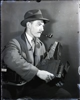 First page of Jack Dixon, photojournalist, with his Graflex camera