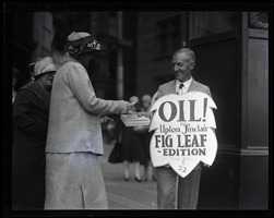 First page of Upton Sinclair at public hearing on censorship of  his novel Oil!, selling copies          and wearing a sandwich board reading 'Oil! Upton Sinclair's Fig Leaf edition'