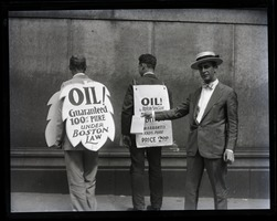 First page of Upton Sinclair and supporters (including son David?) protesting at censorship hearings for          his novel Oil!: showing back side of sandwich boards protesting censorship