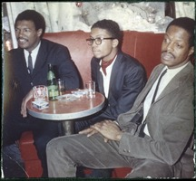 First page of Herbie Hancock (center) searted in a booth at the Jazz Worshop