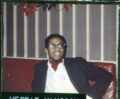 First page of Herbie Hancock: half-length portrait seated on a bench at the Jazz Workshop