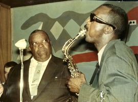 First page of Giuseppi Logan (right) and Jimmy Rushing performing at the Jazz Workshop