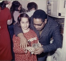 First page of Dizzy Gillespie with a young girl in Bernie Moss's kitchen