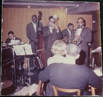 First page of Dizzy Gillespie (trumpet), Kenny Barron (piano), Chris White (bass), James Moody       (saxophone), and Rudy Collins (drums) performing at the Jazz Workshop