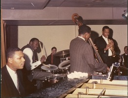 First page of John Coltrane (saxophone), Jimmy Garrison (double bass), Elvin Jones (drums), and       McCoy Tyner (piano) performing at the Jazz Workshop