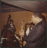 First page of John Coltrane (saxophone),  Elvin Jones (drums), and Jimmy Garrison (double       bass) performing at the Jazz Workshop