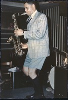 First page of Dexter Gordon: performing at Boston jazz club in checked jacket, shorts, and knee       socks