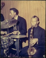 First page of Sonny Rollins (saxophone) and Roy McCurdy (drums) performing onstage, possibly at the Jazz Workshop