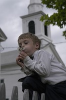 First page of Church supper at the First Congregational Church, Whately: boy blowing on the             seed head of a dandelion in front of the church