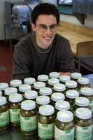 First page of Young man seated in front of jars of Real Pickles pickles