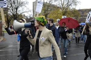 First page of UMass student strike: strike organizer with a bullhorn, leading the march             outside the Student Union building