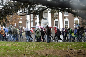 First page of UMass student strike: strikers marching past Goodell Hall