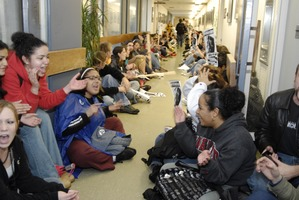 First page of UMass student strike: strikers occupying the hallways in Whitmore Hall leading             to the Chancellor's office