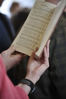 First page of Aftermath of the Congregational Church fire in West Cummington, Mass.:             close-up of parishioner singing from a hymnal