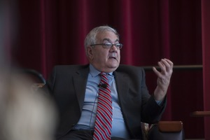 First page of Congressman Barney Frank seated on the Student Union Ballroom stage, UMass Amherst, during his book event