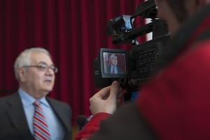 First page of Congressman Barney Frank being interviewed on television at the Student Union Ballroom stage, UMass Amherst, during his book event