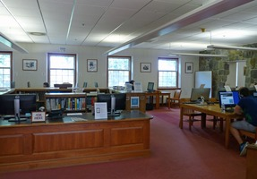 First page of Jones Library: interior with reference desk and reading area
