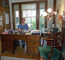 First page of Jones Library: Sharon Sharry, Library Diretor, seated in the Director's office