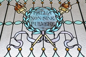 First page of Dickinson Memorial Library: close-up of stained glass window 'Palma non sine             pulvere'