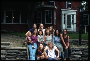 First page of The  women, Montague Farm Commune Includes: Susan Kramer (top row center), Verandah Porche (center row, 2d from             right), Janice Frey (front row right)