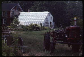 First page of Tractor parked in front of greenhouse and house, Montague Farm Commune