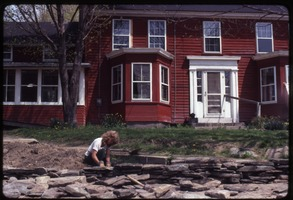 First page of Janice Frey setting a stone wall in front of the house, Montague Farm Commune
