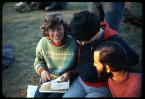 First page of  Letter writing outside (Nancy, Cate, Alan): Occupation of the Seabrook Nuclear Power Plant Occupiers writing a letter in the armory yard (l. to r.): Nancy Hazard, Cat             Woolner, Alan Berman
