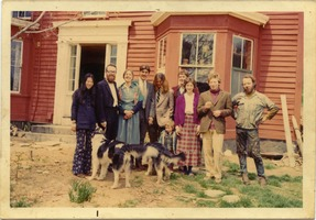 First page of Group posed in front of the farmhouse, Montague Farm Commune Includes: Steve Sayers (2d from left), Tony Mathews (4th from left), Nina             Keller (3d from right), Chuck Light, and Michael Curry
